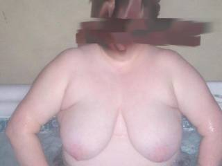 Wifes big saggy tits out in the hot tub