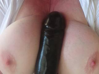My Big Black Dildo fucking my tits. Does it fit?