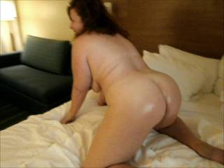 Wife doggy pose on bed waiting for lover in hotel
