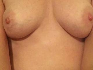 I just love her tits, great view as she\'s riding me. Who wants a turn?