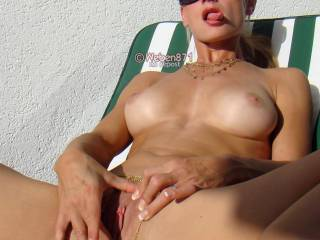 Gently fingering my pussy on the balcony of the hotel...