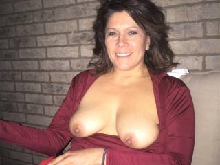 Melissa was sitting on our porch one night when storm had just rolled thru, so she had to put a light blanket on her legs....but for some reason her tits weren\'t cold and they popped out of her shirt.