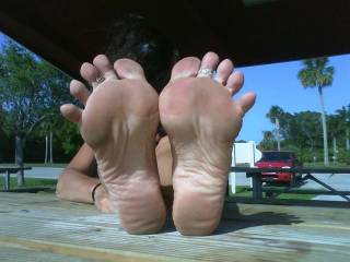 WOW! ... excellent pic. This is an invitation that I couldn't refuse. I would love to put my cock in between her damn hot feet and slam my balls into her arches and fucken cum heaps! 10/10 and goes into my 'Good times' collection.
