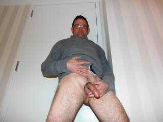 Naked with  my cock ring on in a hotel room.  Msg me if you\'d like me to make a tribute pic for you.