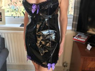 Wonderful partner posing in PVC dress.