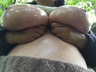 I should have brought an umbrella into the woodland, as the oil she put over her big tits was dripping down - which is where I was taking this picture from !