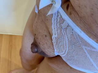 Trying on some white crotchless panties to show off my cute little cock.  Is he looking good or what?