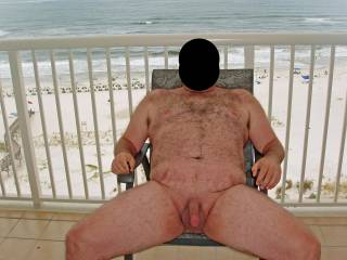 Hubby posing in the nude at our condo while on our summer 2008 beach vacation.  Could not hear the knock at the door...a very pretty lady from housekeeping walked in and saw hubby as this pic was being taken!
