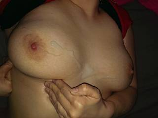 After a handjob, I\'ve covered those tits with a huge load of cum. You like it?