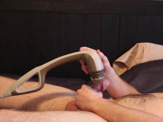 Using a massager to cum by stimulating my frenulum.  It took 12 mins, but I edited it down to less than 2.  Fast forward to the end for the cumshot.  You\'ll see that it\'s weird: I didn\'t get fully hard but came a ton!