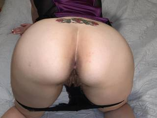 Hubby wanted an ass shot to share with potential bulls to fuck me. He asked me to put on a temp tramp stamp to make me feel naughty. (He's silly!). Hopefully he'll find at least  a few guys interested in doing very bad things to me while he watches...