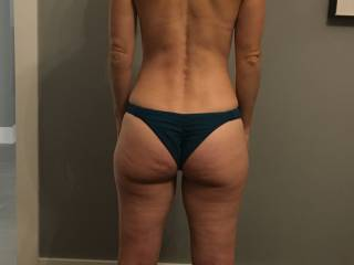 Here she is in some new bikini bottoms.She can\'t wait for the summer to show off her sexy ass at the beach. I think this shows off the perfect amount of ass.Should I buy her something that shows off even more ass? Would you enjoy seeing her at the beach?