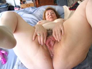 yummm very much,just the way she is holding her legs up and spreading her cunny such a sexy mature married woman i just enjoy fucking mmmm