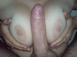 Beautiful tits, big uncut cock....my mouth is watering and my cock is throbbing.