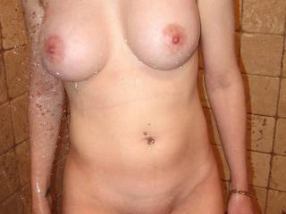 I would love to fuck her gorgeous, little, shaved pussy and cum all over those beautiful tits.  They surely are perfect for sucking, fucking, and covering in cum.