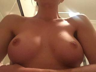 Greatly enhanced set of tits.. equally beautiful pussy to match.. this girl is in the series of doggystyle fucking pics.. see if you can spot her