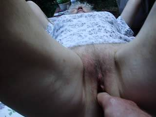 playing with her nice pussy outside on deck..