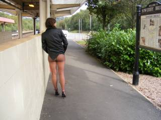 at local train st. flashing her pussy and arse in sheer tights