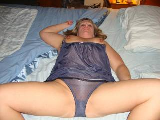 confronted with this, I can tell you I'd very slowly and patiently kneel on the floor, run my hands under her legs and kiss my way, very slowly up her inner thighs to poise my lips over hers, breathing in her wonderful scent, then blowing my hot breath on her sexily covered pussy.  mmmmmmmmmm the thought.....