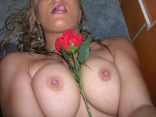 I'd like to replace that rose with my throbbing cock , poking it's swollen head out for you to lick . Then I'd put you on your hands and knees and fuck your ass while you reach back and squeeze my balls until my hot cum spurts deep inside....:)