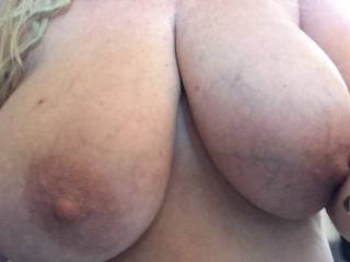 """This mature woman has in insatiable appetite. She\'s always """"hungry"""". I love fucking her. She sent me this picture of her big tits to tease me and show me what to expect when I walked in the door. Don\'t you just love mature women like that?"""