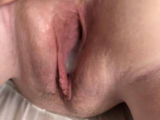 The the cum is just about to pour out of my little cunt. Anyone want to fuck my pussy freshly lubed with his spunk?