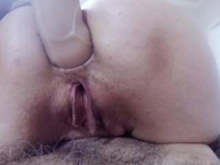 When he reached over for a larger toy and began to really punch at my guts, I had him slide in beneath me so I\'d have a pacifier to help balance the fierce pounding in my ass. He loves trying to coax my pussy into spewing out of control!