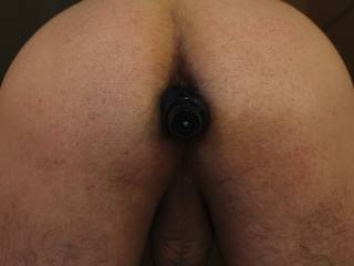 Bent over with vibrator in