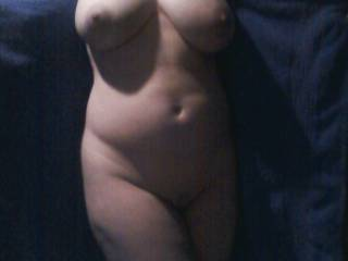 Wife showing off her pregnant body.