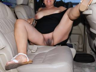In the back seat of a vehicle that's parked in shopping center parking lot with the door wide open...Flashing my tits and pussy for the camera and anyone who looked in our direction!