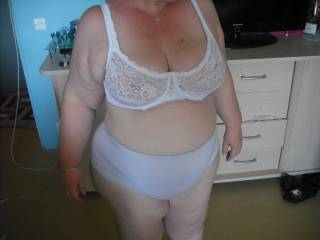 Very nice.  Love the big panties and the lacy, sheer bra on your curvy body.