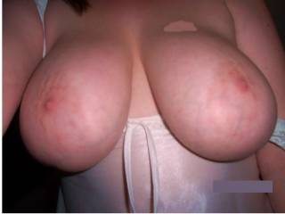 My womans big juicy tits!. I love to grab them and suck on them:). Ps. She loves cum pics;)