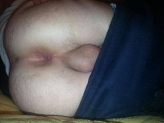 I wass really horny and so I shaved my asshole cock and balls I went and layed down pulled my pants and undies over my ass lifted and spread my ass selfie 