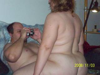 My wife riding Sportluvr\'s cock as he takes a photo of her and I take a photo of them.