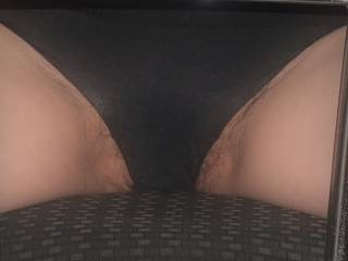 Posing on a Chair with wide spreaded legs. Look at her hairy pussy, it is wide open!