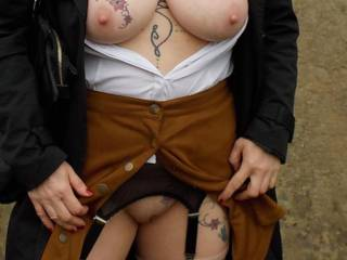 With only two poppers done up on Sally's skirt it was obvious there would be some pussy on show!
