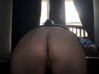Bent over and ready to be fucked.