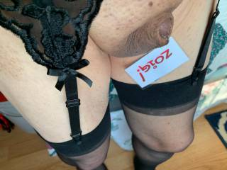 I thought that I would try on some sexy lingerie and post on Zoig.  I think I look good in black thigh highs and a garter belt to match.