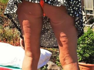 Blonde milf showing her ass in public in a very short dress