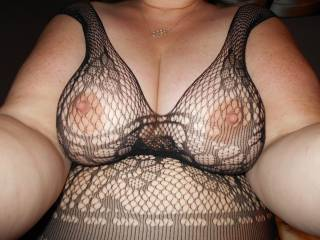I love how her nipples poke through.  They never seem to tire of attention.
