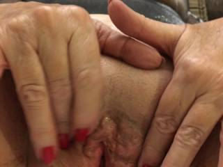 Holding my shaved wet cunt open - do you like?