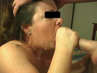 My wife sucking dick with cum on her face