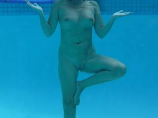 Underwater yoga in the swimming pool at home.