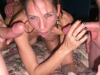 Bulls friend fucking my tight pussy hard while I suck two hard cocks.... I love it!