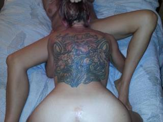 Love that fantastic tat on her back and those lips hiding under that sweet, sweet ass!