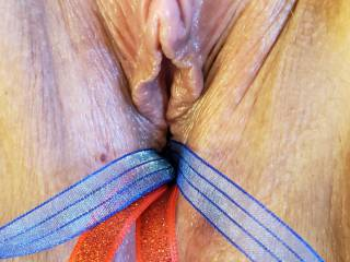 My lady and I were just playing around and we had these ribbons that I thought would look awesome in her pussy and show off her pretty clit.