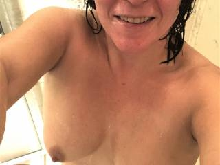 Melissa had just gotten into the shower, and decided to take a pic of her titties.....