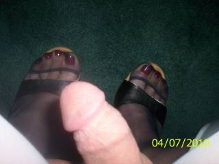 yes  id love to suck on those  sexy toes and give  him some attention as well maybe he could come on your feet and id clean them up for you afterwards