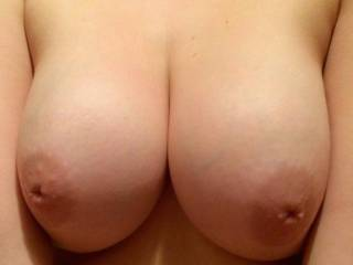 Mmm wow so beautiful! I love those tits, want to take each nipple in my mouth and lick and suck them, I want my hands all over them and then to finish off the worship of her amazing boobs I'd slide my hard cock between them and fuck them nice and slow until I shoot a huge load all over them