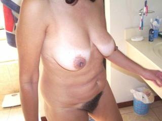 I love you tits and also enjoy a Gal with a hairy pussy.  Would you like to get together for some hot sex - I love to eat pussy as well and make you cum in my mouth.
